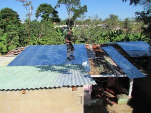 Luke putting new panels on Abuela's roof.  You can see the old one was...old.